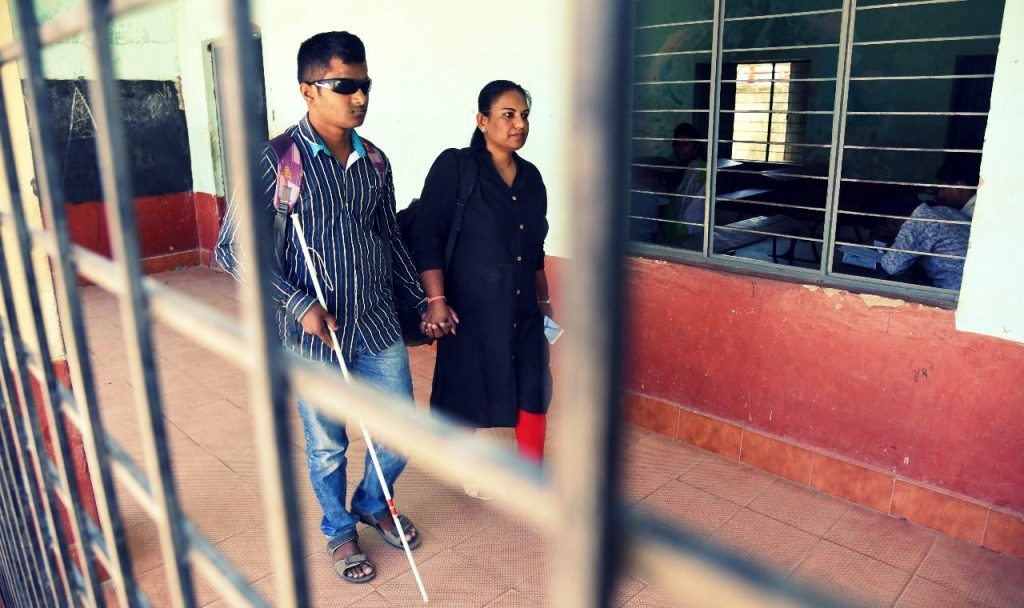 Pushpa Preeya with a blind candidate